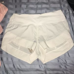White lululemon shorts with quilted detailing